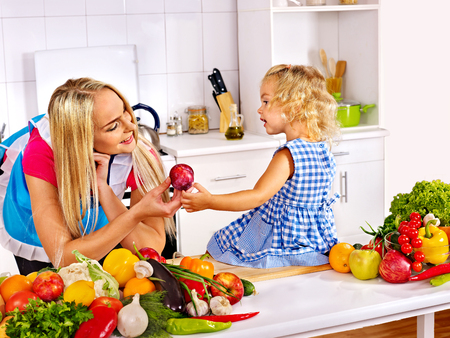Mother and daughter prepare at kitchen. photo