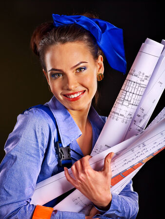Builder woman with roll wallpaper. Fashion, photo
