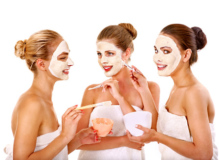 medical mask: Group woman getting facial mask and gossip . Isolated.