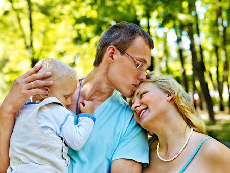 enceinte: Pregnant woman  with family outdoor in park. Stock Photo
