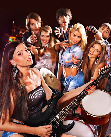 Musical group playing in night club. Male and female. photo