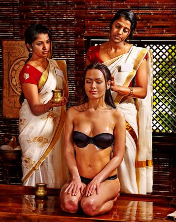 head massage: Young woman having head ayurveda spa treatment.