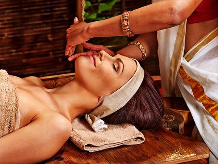 Woman having facial  ayurveda spa treatment. photo