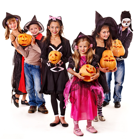 Halloween party with group children holding carving pumpkining pumpkin photo