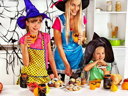 Happy family with children preparing halloween food. photo
