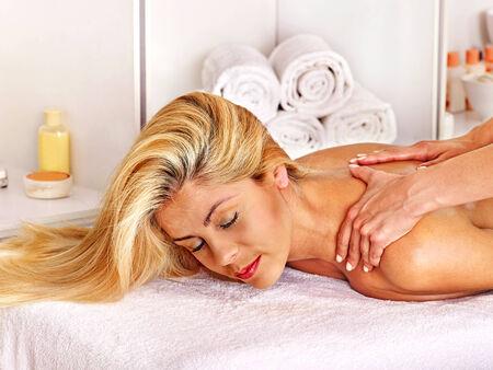 Blond beautiful woman getting massage. photo