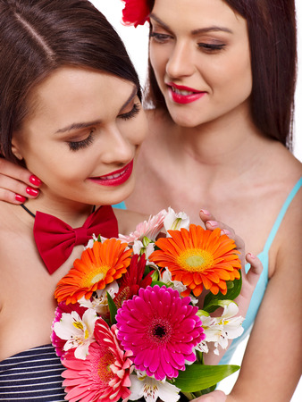 Two sexy lesbian women with flower. Isolated. photo