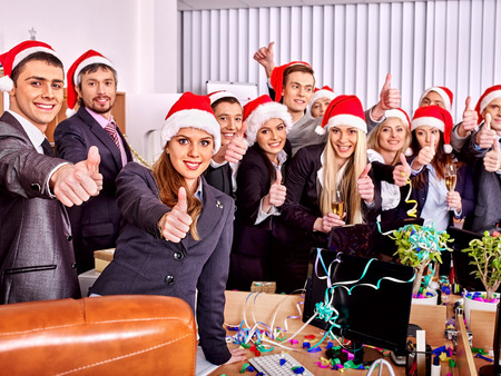 Business group people in santa hat at Xmas party. photo
