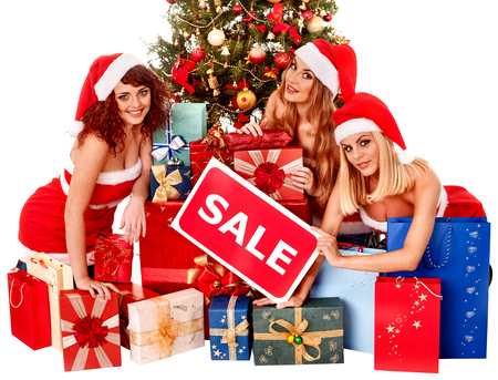 Women in Santa hat holding sign saying sale and gift box. photo