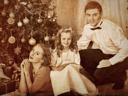 Happy family with children  dressing Christmas tree. photo