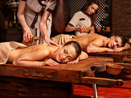woman in spa: Couple  having oil Ayurveda spa treatment. Stock Photo