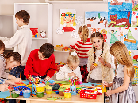 children painting: Child painting at art school. Education. Stock Photo