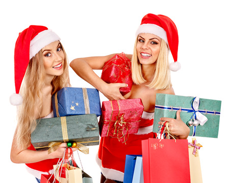 Women in Santa hat holding stack Christmas gift box. photo