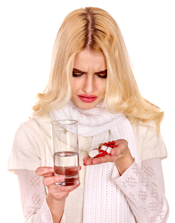 Young woman having flu takes pills. Isolated. photo