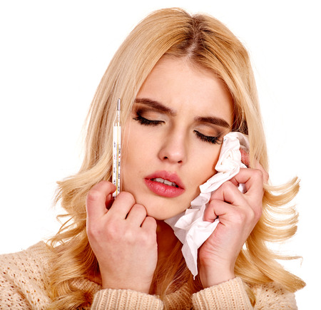 Young woman having  flue taking thermometer. Isolated. photo