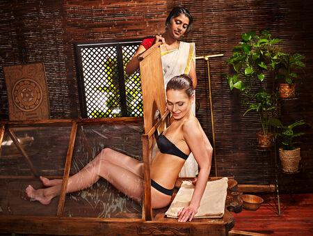 ayurvedic: Woman having Ayurvedic sauna treatment.