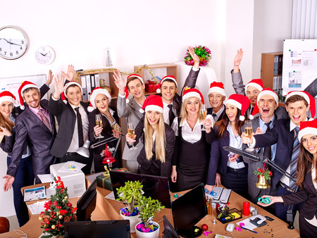 Happy group people in santa hat at Xmas business  party. photo