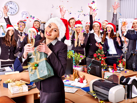 Happy business group people in santa hat at Xmas party. photo