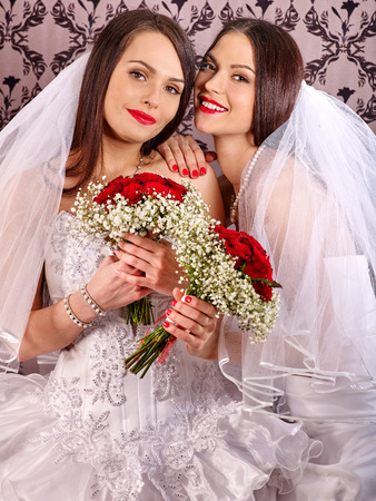 lesbians: Wedding lesbians girl in bridal dress. Indoor.