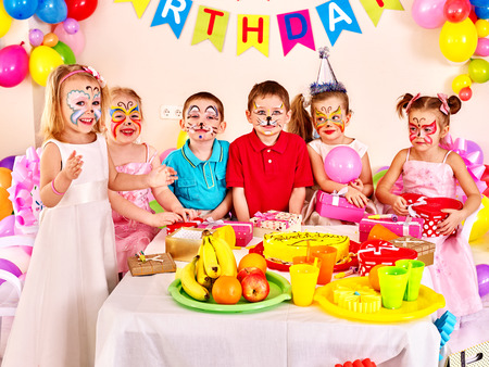 Group of children happy birthday party . Food on table.