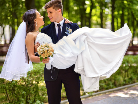 Bride and groom with flower summer  outdoor. Archivio Fotografico