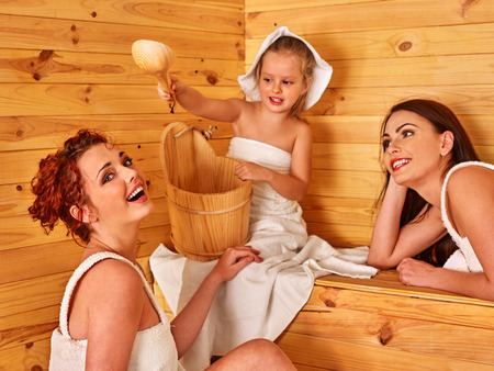 body temperature: Group people with child in sauna. Healthy lifestyle. Stock Photo