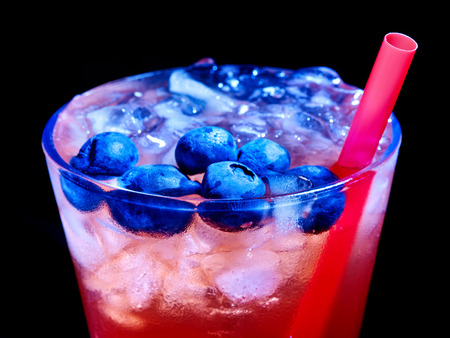 Cold red blueberry drink  with berry . Top view. photo
