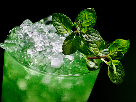 Green drink  with mint leaf on dark background. Top view. photo