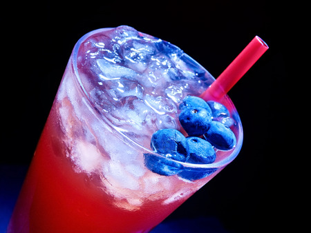 Cold red blueberry drink  with a lot of berry . Top view. photo