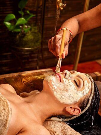 east indian: Woman having facial mask at ayurveda spa. India culture.