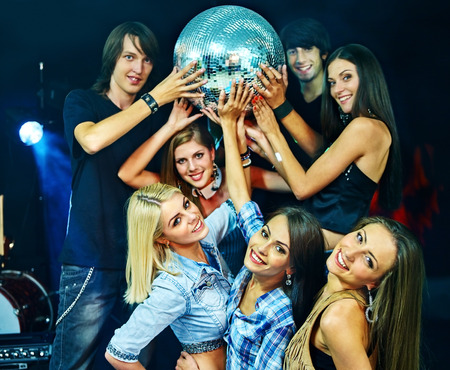 lighting effects: Woman and man on disco in night club taking party ball. Lighting effects.