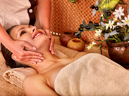 head massage: Woman getting head massage in tropical beauty spa. A lot of flower.