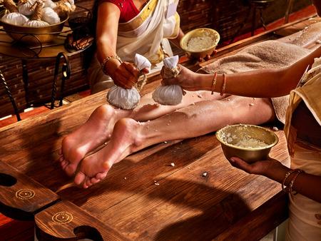 panchakarma: Young woman having feet Ayurveda India spa massage.