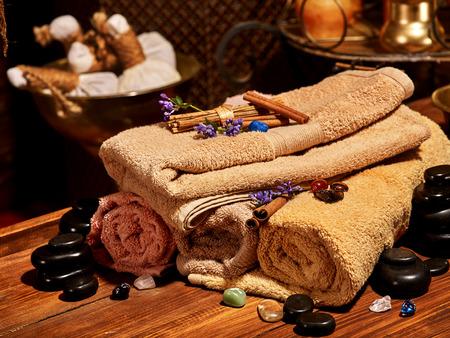 ayurvedic: Luxury ayurvedic spa massage still life. Towel and stone.