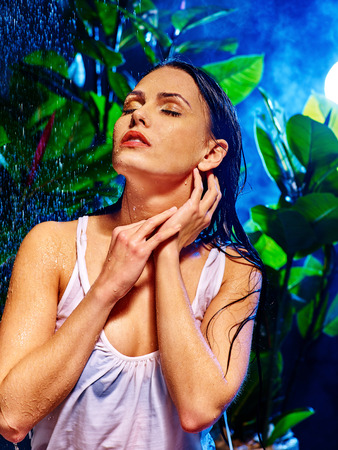 wetting: Wet woman with water drop on the background of green plants. Stock Photo