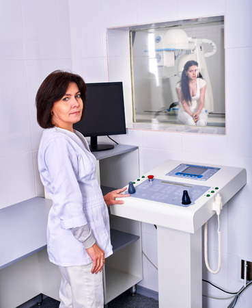 x ray machine: Female doctor checking patient  in x-ray room.