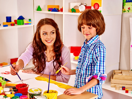 children painting: Family with children  painting  in school. Education. Stock Photo