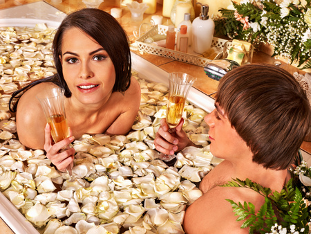 couple bathroom: Couple relax  at luxury spa with flower.