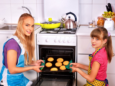 Mother and daughter bake cookies. Kitchen  at home. photo