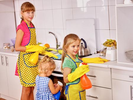Children little girl cooking at kitchen. Archivio Fotografico