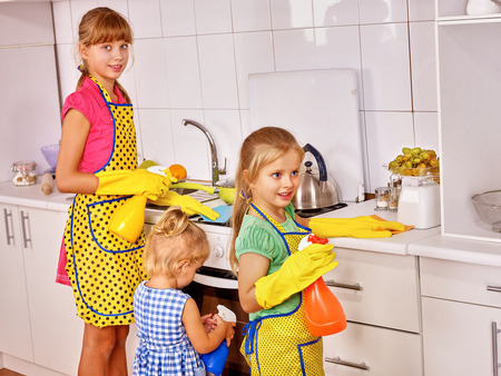 Children little girl cooking at kitchen. Standard-Bild