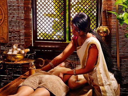 panchakarma: Young woman having oil Ayurveda spa treatment. On window background.