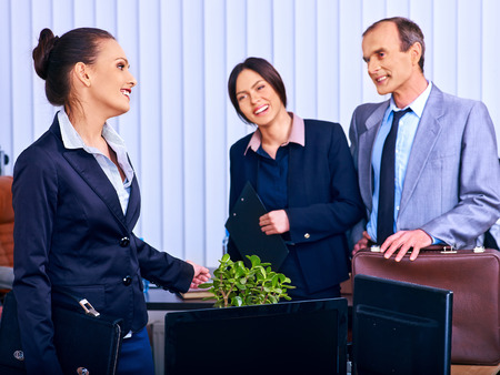 Happy group business people in office. Three people. Stock Photo