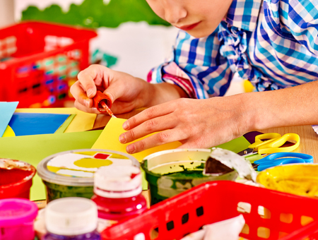playschool: Little girl painting picture at school. Education. Body part.