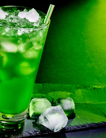 crushed ice: Green drink  with crushed ice . Half of glass. Stock Photo