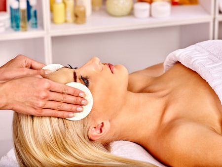 bare shoulders: Blond woman getting head massage at spa. Bare shoulders.