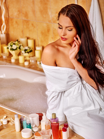 lying in bathtub: Woman washing at home luxury bath.