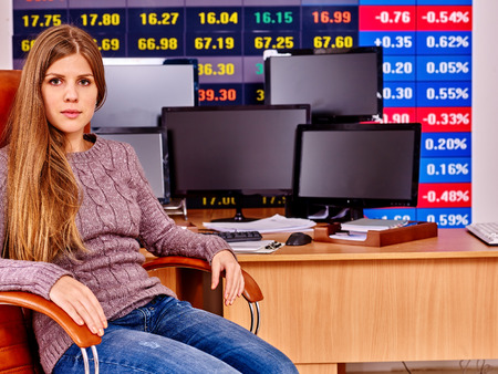Woman with  stock exchange board play forex in office. photo