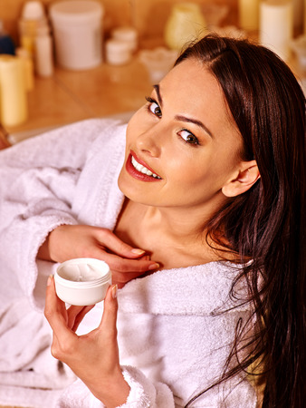 woman neck: Woman relaxing at home luxury bath. Girl put the cream on neck and shoulder.