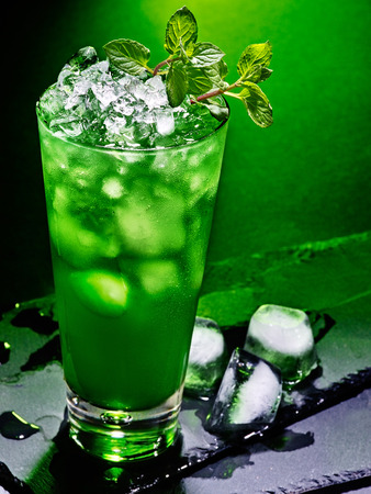 crushed ice: Green drink  with crushed ice and mint leaf on dark background 43